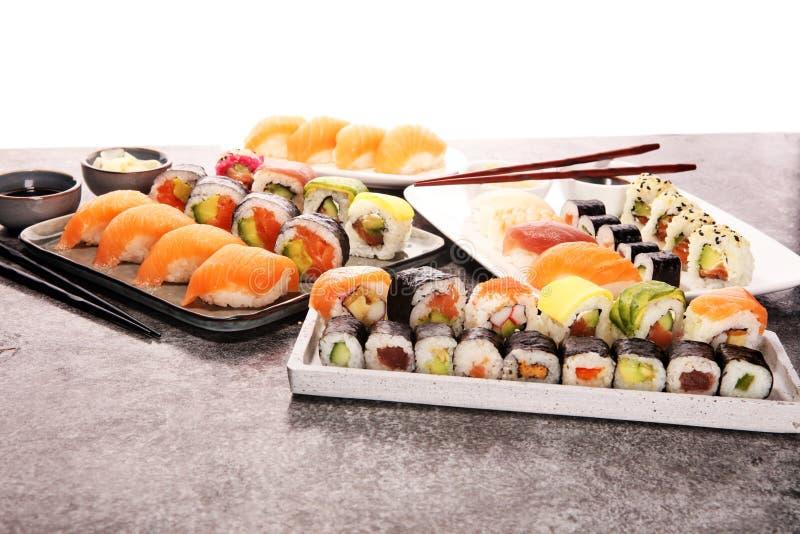 Close up of sashimi sushi set with chopsticks and soy - sushi roll with salmon and sushi roll with smoked eel. Selec.tive focus royalty free stock photos
