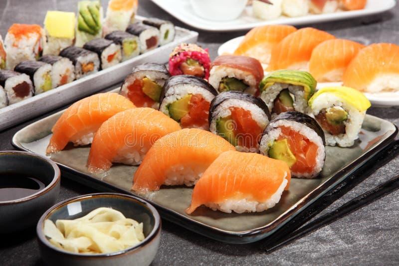 Close up of sashimi sushi set with chopsticks and soy - sushi roll with salmon and sushi roll with smoked eel. Selective focus stock photos