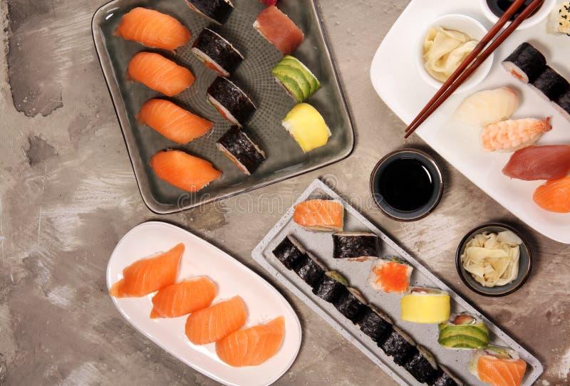 Close up of sashimi sushi set with chopsticks and soy - sushi roll with salmon and sushi roll with smoked eel. Selective focus stock photo