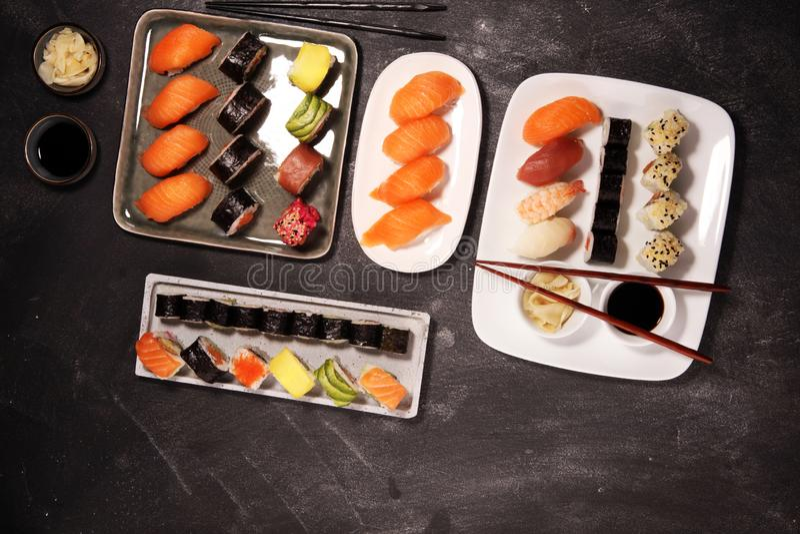 Close up of sashimi sushi set with chopsticks and soy - sushi roll with salmon and sushi roll with smoked eel. Close up of sashimi sushi set with chopsticks and stock photo