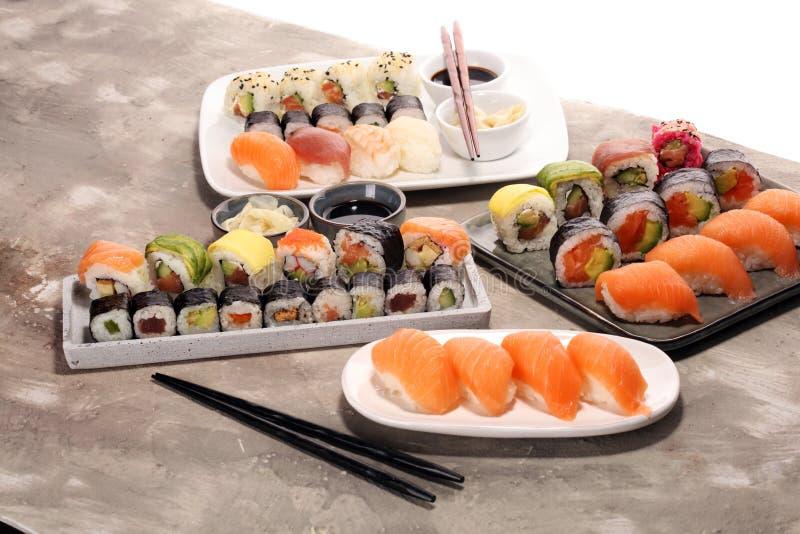 Close up of sashimi sushi set with chopsticks and soy - sushi roll with salmon and sushi roll with smoked eel. Close up of sashimi sushi set with chopsticks and stock photos
