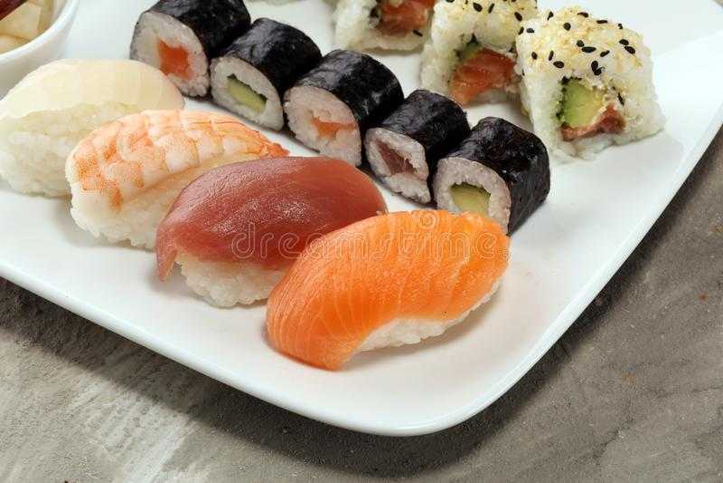 Close up of sashimi sushi set with chopsticks and soy - sushi roll with salmon and sushi roll with smoked eel. Sele.ctive focus royalty free stock photo