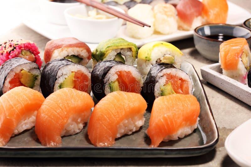 Close up of sashimi sushi set with chopsticks and soy - sushi roll with salmon and sushi roll with smoked eel. Close up of sashimi sushi set with chopsticks and royalty free stock image