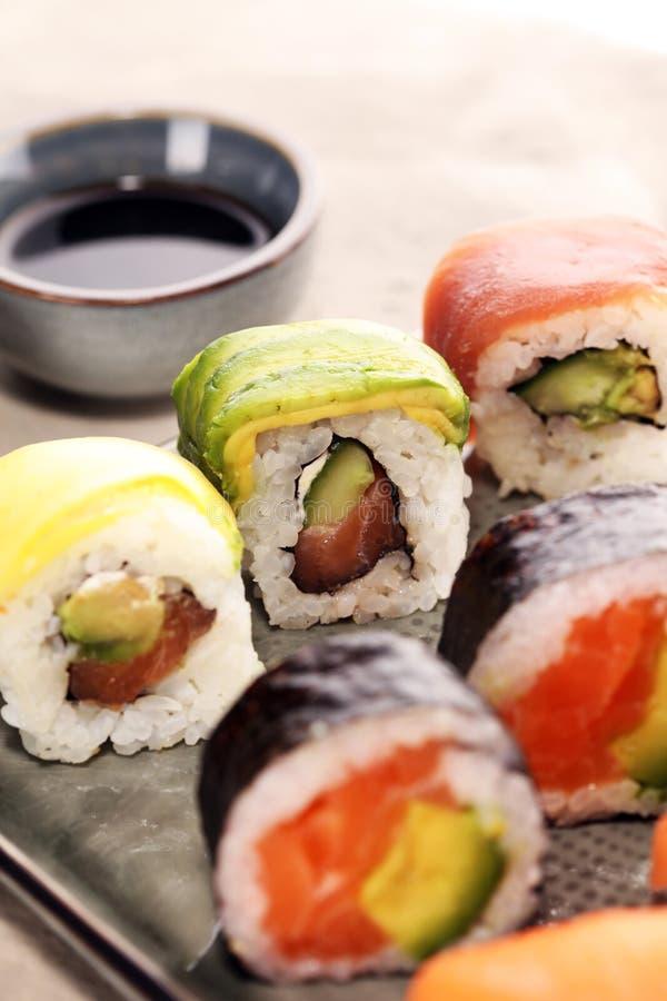 Close up of sashimi sushi set with chopsticks and soy - sushi roll with salmon and sushi roll with smoked eel. Selective focus stock photography