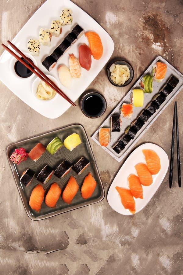 Close up of sashimi sushi set with chopsticks and soy - sushi roll with salmon and sushi roll with smoked eel. Selective royalty free stock image