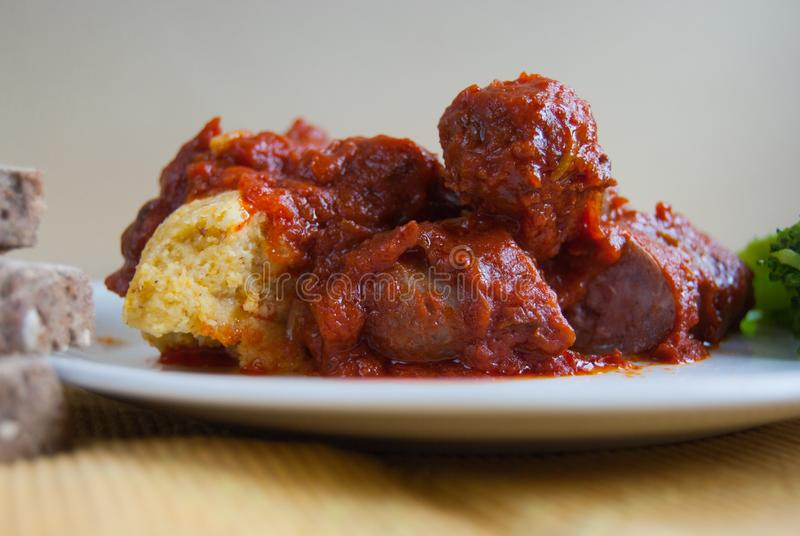 Close up of a sausages with tomato sauce and polenta stock images