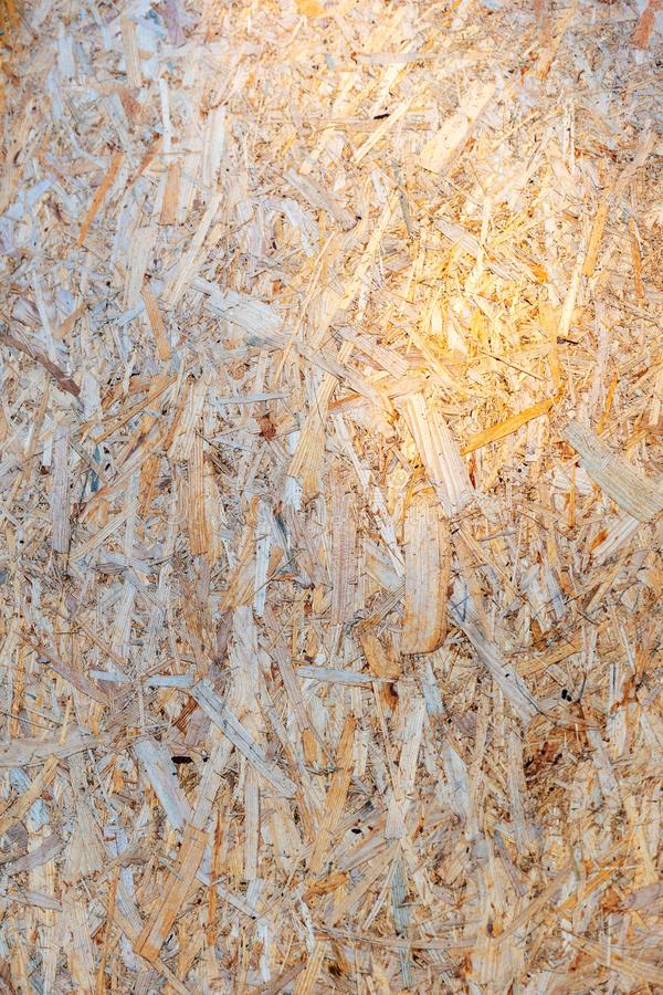 Close up sawdust texture. Surface of plywood. Pressed tree chips. Image royalty free stock image