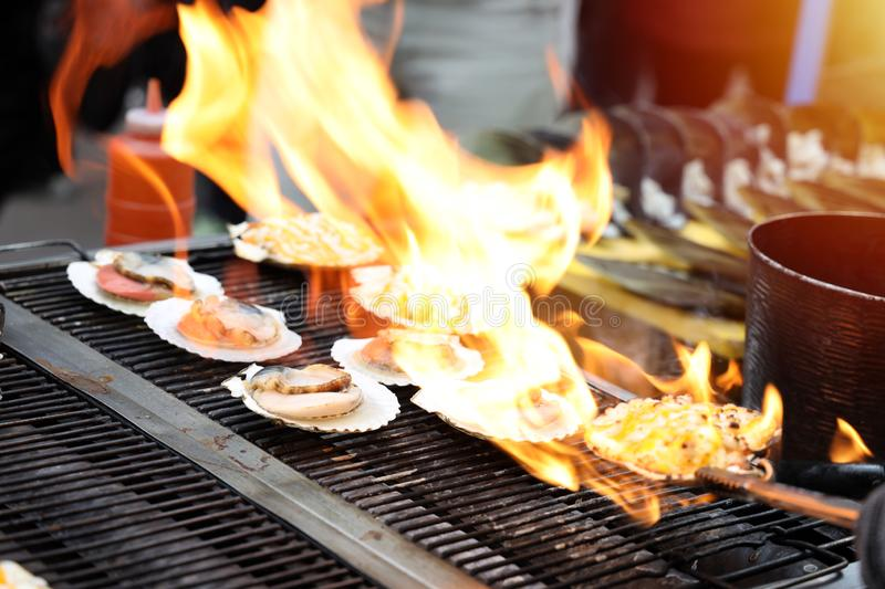 Close up Scallop burned on charcoal stove, street food. In Seoul, South Korea stock images