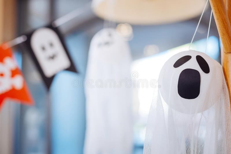 Close up of scary white ghost used as Halloween decoration for children party stock images