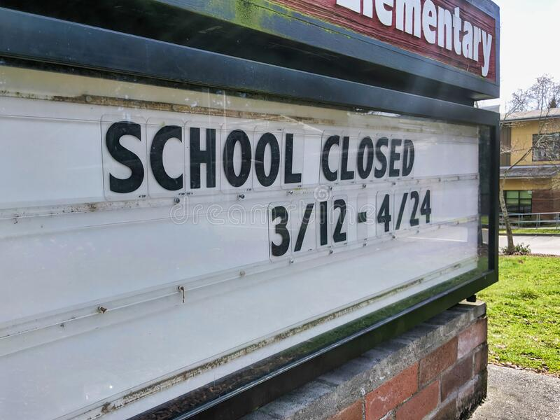 Close up of a School Closed sign after several Washington counties close to quarantine against the coronavirus outbreak stock photo