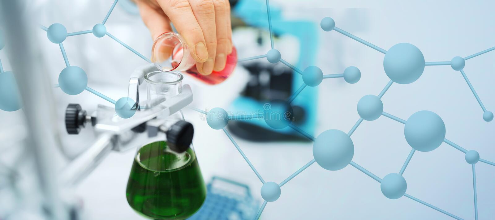 Close up of scientist filling test tubes in lab royalty free stock photos