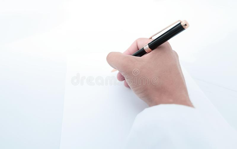 Close up.the scientist makes a record on a blank sheet. Photo with copy space royalty free stock images