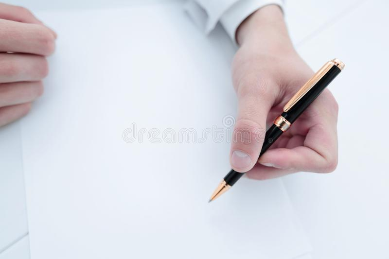 Close-up of the scientist makes a record sitting at the laboratory table. Science and health stock images