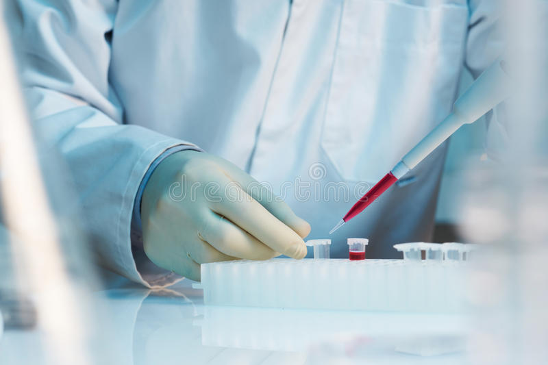 Download Close Up Of Scientist Using Pipette In Laboratory Stock Photos - Image: 23412893
