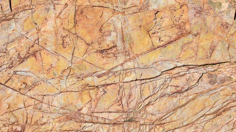 close up of a scratched old orange stone of an architectural wall decorating the interior of a house. Horizontal photo stock images