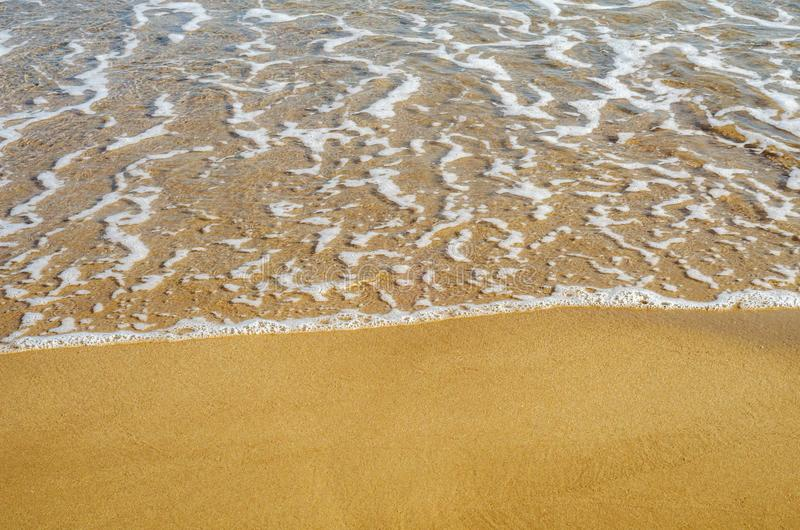 Close up of the sea water affecting the sand on the beach, sea w royalty free stock photography