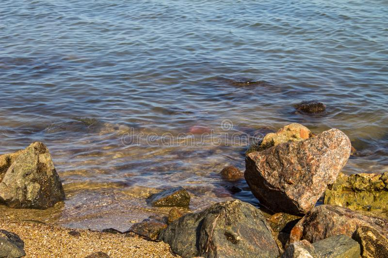 Sea waves splashing over rocks royalty free stock photography