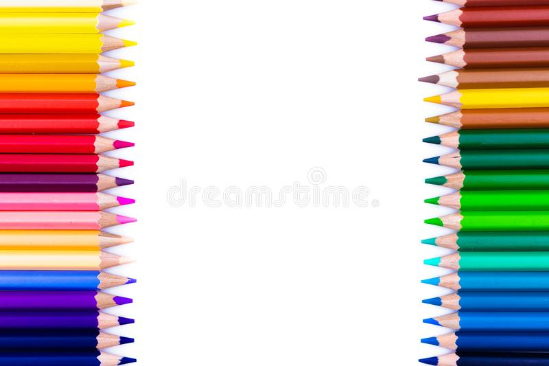 Close up seamless colored pencils row isolated on white background. Colorful pencils with copy space for your text. royalty free stock image