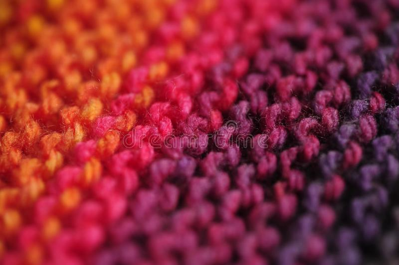 Close up of seamless knitted diagonal patterns in vivid rainbow mixed colors with shallow selective focus. Macro photograph of seamless knitted diagonal patterns royalty free stock photos
