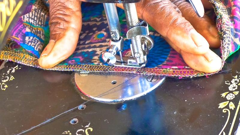 Close up of Seamstress making clothes on an old Singer Sewing Machine stock photography