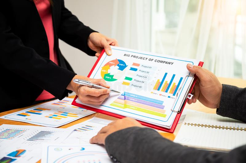 Close up of Secretary present big project report to executive managing director stock images