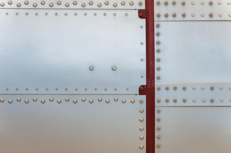 Abstract background of metal and rivets. A close up section of the outer layer of a rocket providing an abstract background of metal and rivets royalty free stock photos
