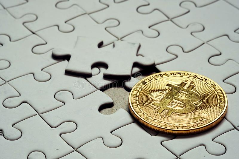 Close up a select focus gold bitcoin and Final piece of jigsaw puzzle. royalty free stock photo