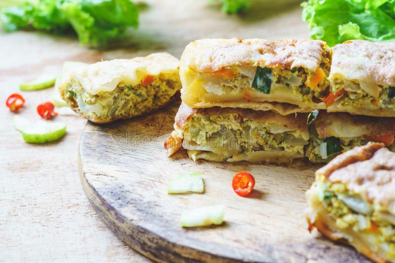 Close up selective focus of murtabak or martabak or mutabbaq or Mataba. Murtabak is a stuffed pancake or pan-fried bread which is royalty free stock photos