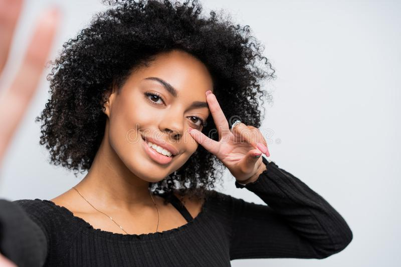 Close up self portrait of a beautiful african american woman taking a selfie. Close up self portrait of a beautiful african american woman taking a selfie royalty free stock image