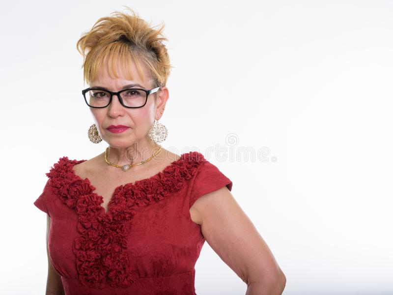 Close up of senior Asian businesswoman wearing eyeglasses agains royalty free stock photography
