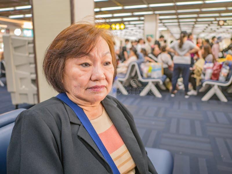 Close up Senior asian woman in don muang internation Airport Bangkok. Thailand royalty free stock photography