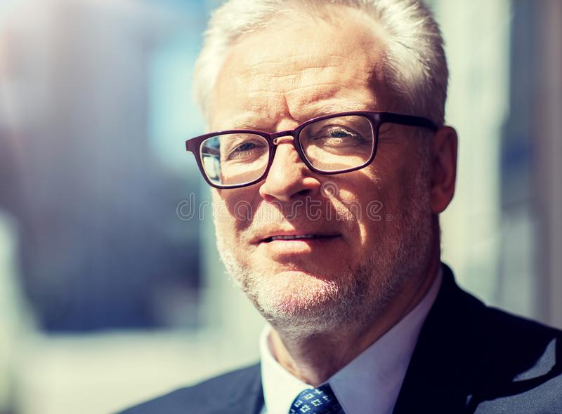 Close up of senior businessman in eyeglasses royalty free stock images