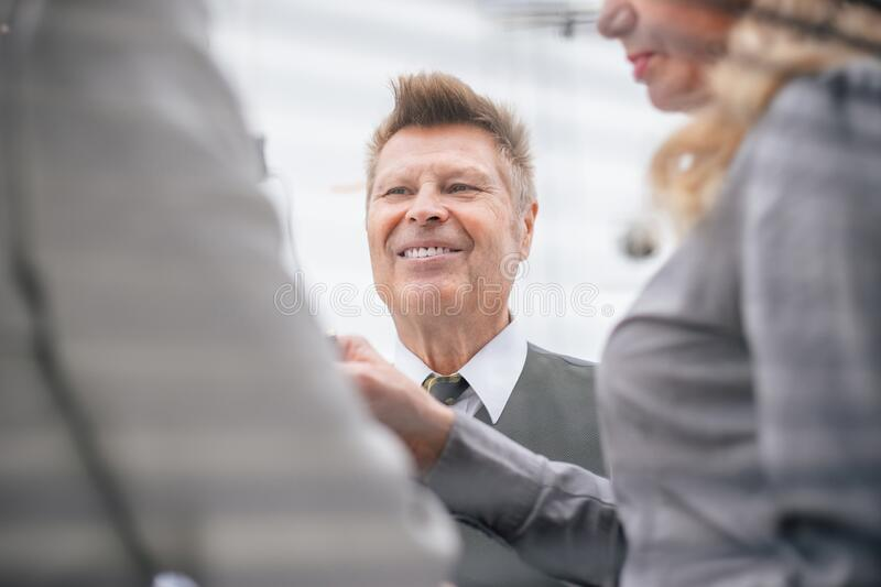 Close up. senior businessman talking to his colleagues. royalty free stock photos