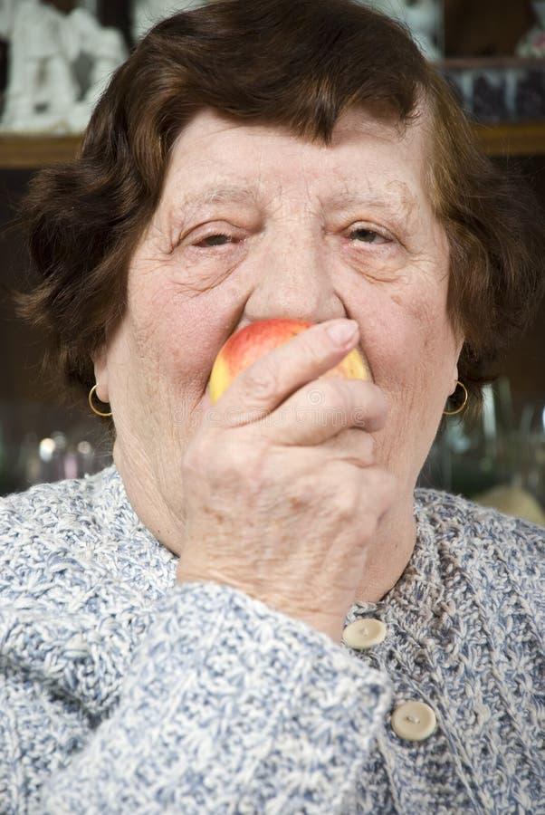 Close up senior eat an apple stock image