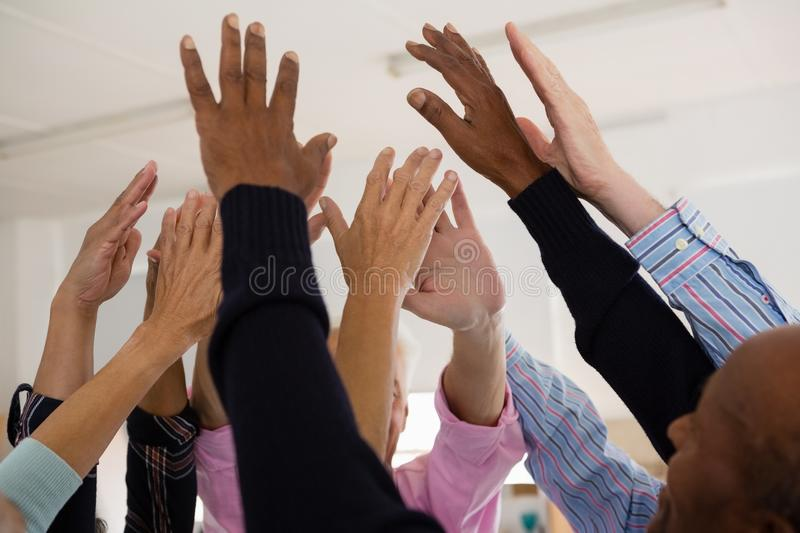 Close up of senior friends with arms raised royalty free stock photography
