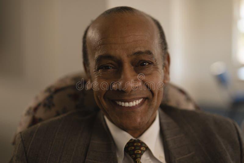 Close-up of senior man looking at camera in nursing home royalty free stock images