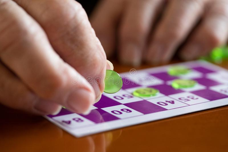 Close Up Of Senior Man Playing Game Of Bingo royalty free stock photography