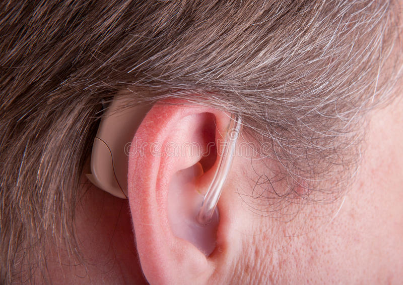 Close-up of a senior man& x27;s ear wearing hearing aid stock photo