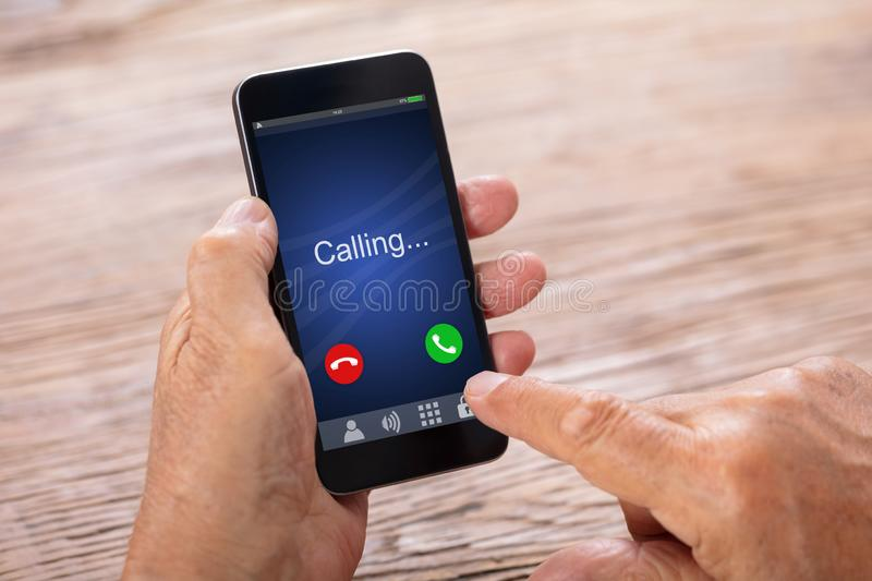 Man Holding Smartphone With Incoming Call. Close-up Of A Senior Man`s Hand Holding Smartphone With Incoming Call stock photos
