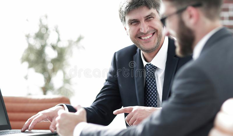 Close-up of a senior manager talking to a colleague. royalty free stock images