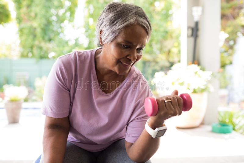 Close up of senior woman exercising with dumbbell royalty free stock photos