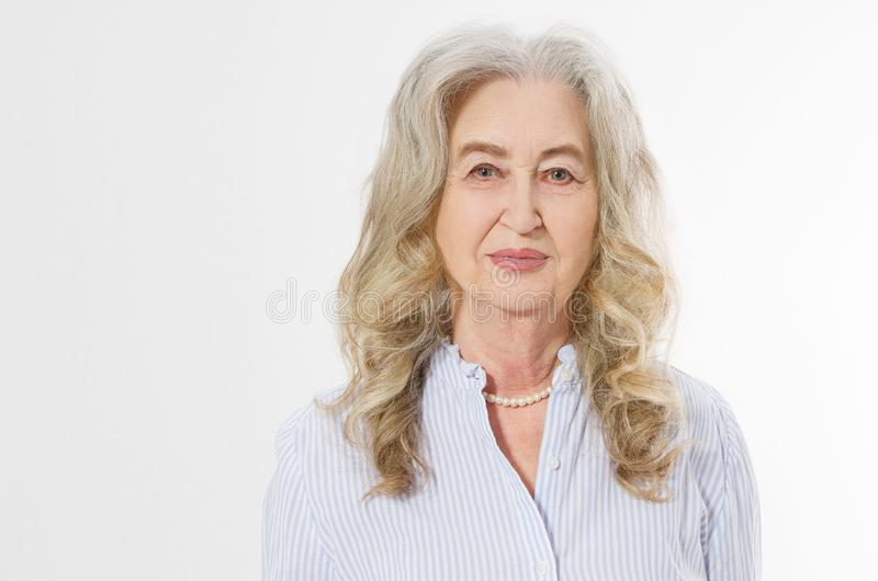Close up of senior woman face isolated on white background. Happy old lady with wrinkled skin. Health care and wrinkles concept. stock photos