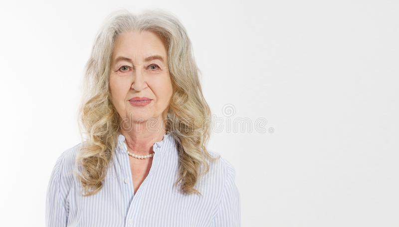 Close up of senior woman face isolated on white background. Happy old lady with wrinkled skin. Health care and wrinkles concept. royalty free stock photo