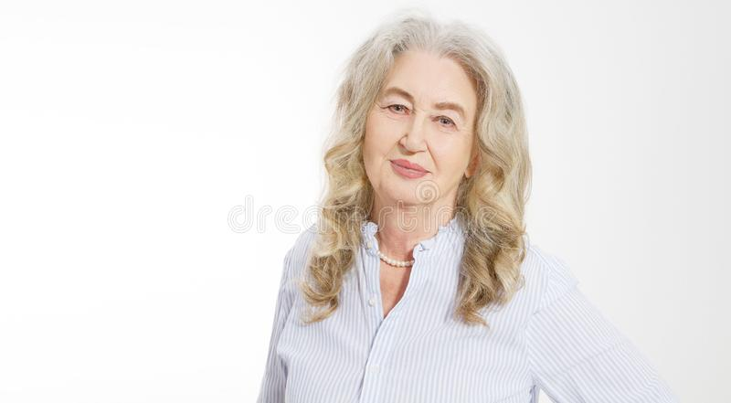 Close up of senior woman face  on white background. Happy old lady with wrinkled skin. Health care and wrinkles concept. royalty free stock photography