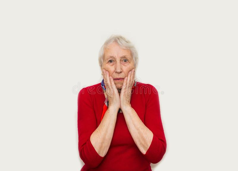 Close-up of a senior woman with horror emotion stock image
