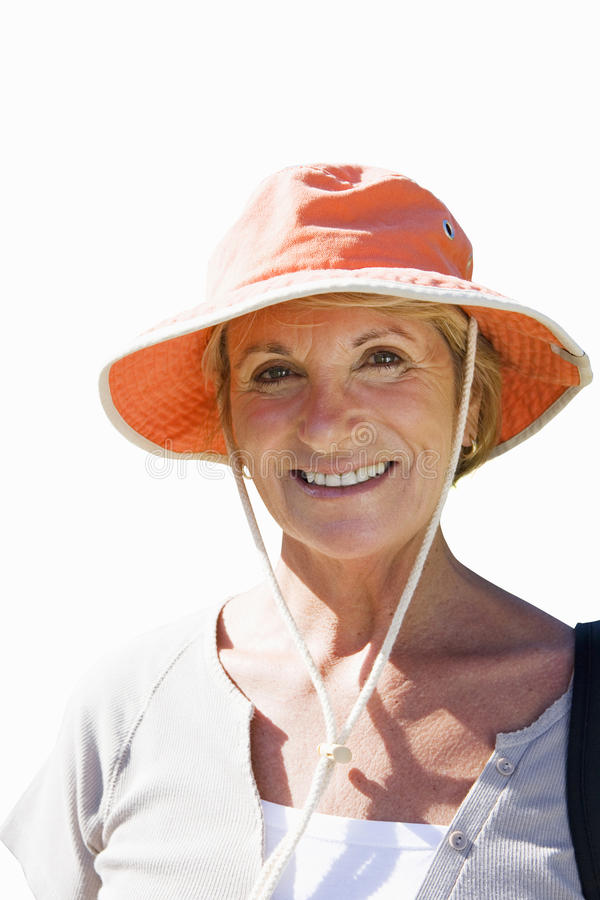 Close-up of senior woman in sun hat, cut out stock photo