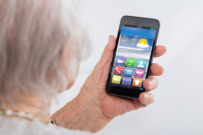 Close-up Of Senior Woman Using Smartphone stock image