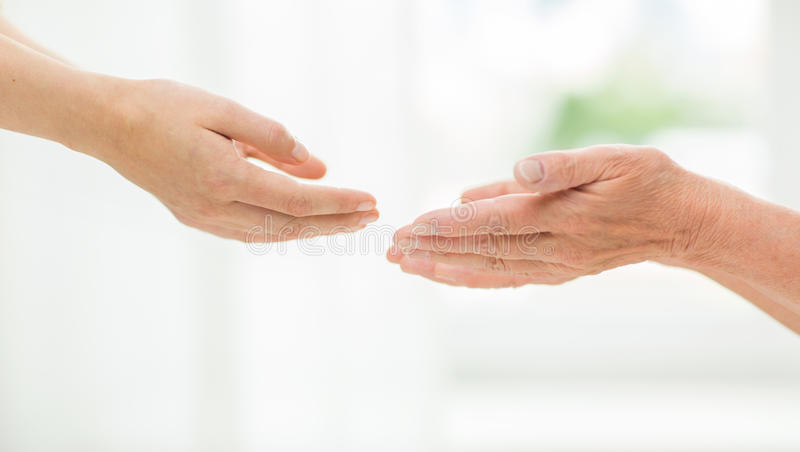 Close up of senior and young woman hands royalty free stock photography