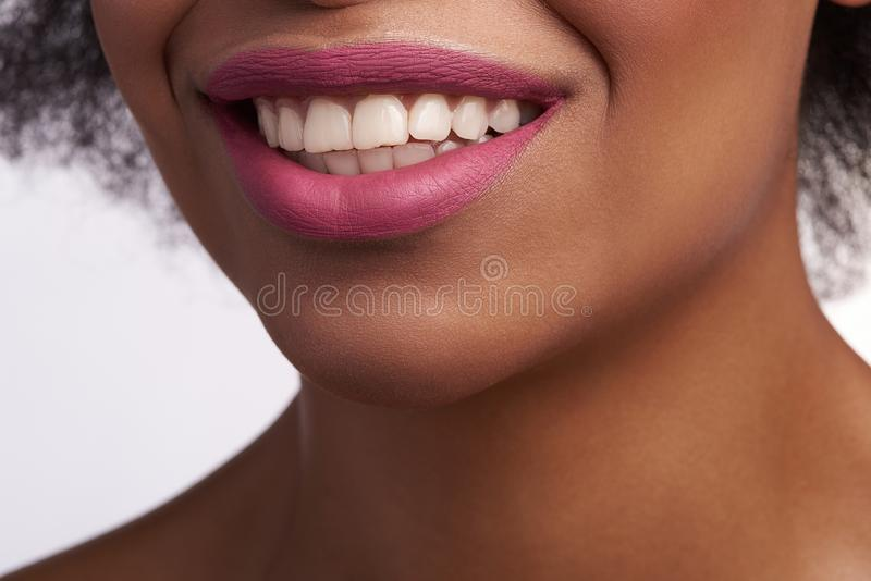 Close up of sensual smiling mouth of ethnic female royalty free stock image
