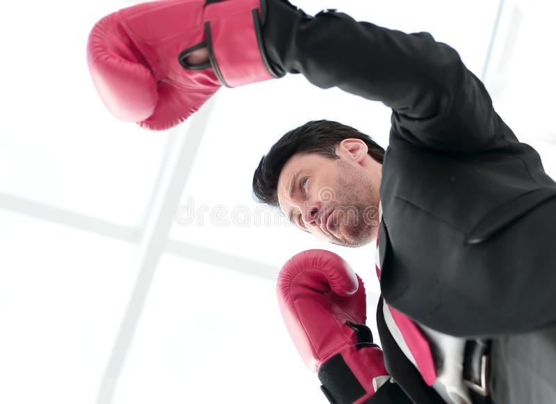 Close up.serious businessman in Boxing gloves. Concept of competitiveness stock image